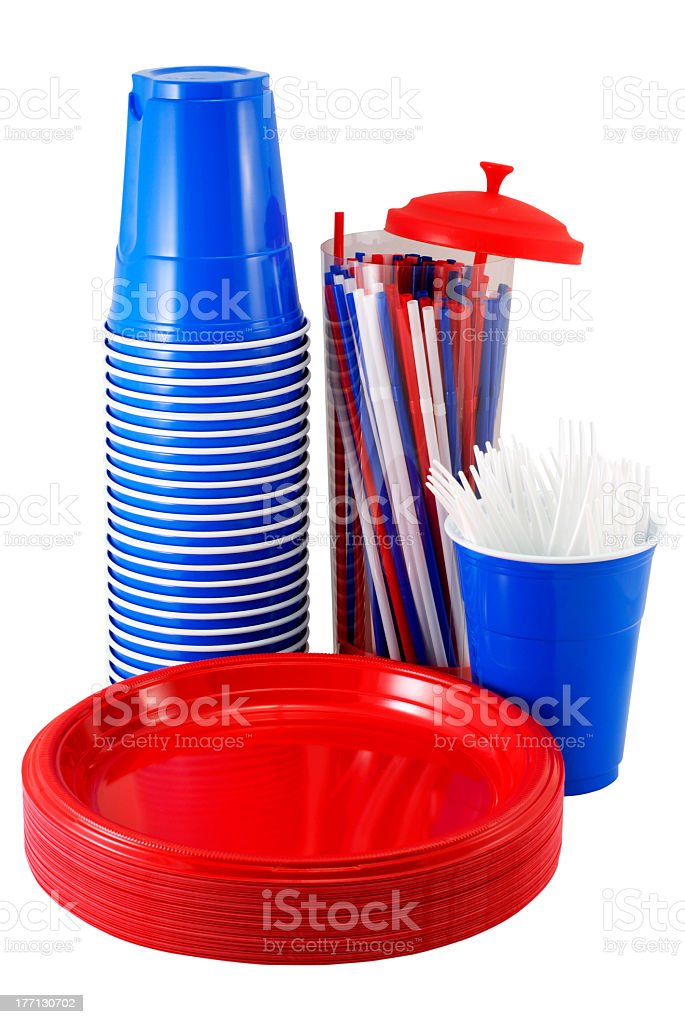 Picnic plates, cups, straws, and utensils in red and blue stock photo