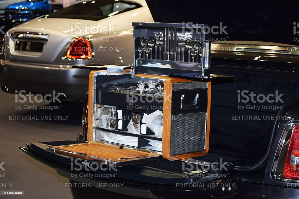 Picnic set in the Rolls-Royce on the motor show stock photo