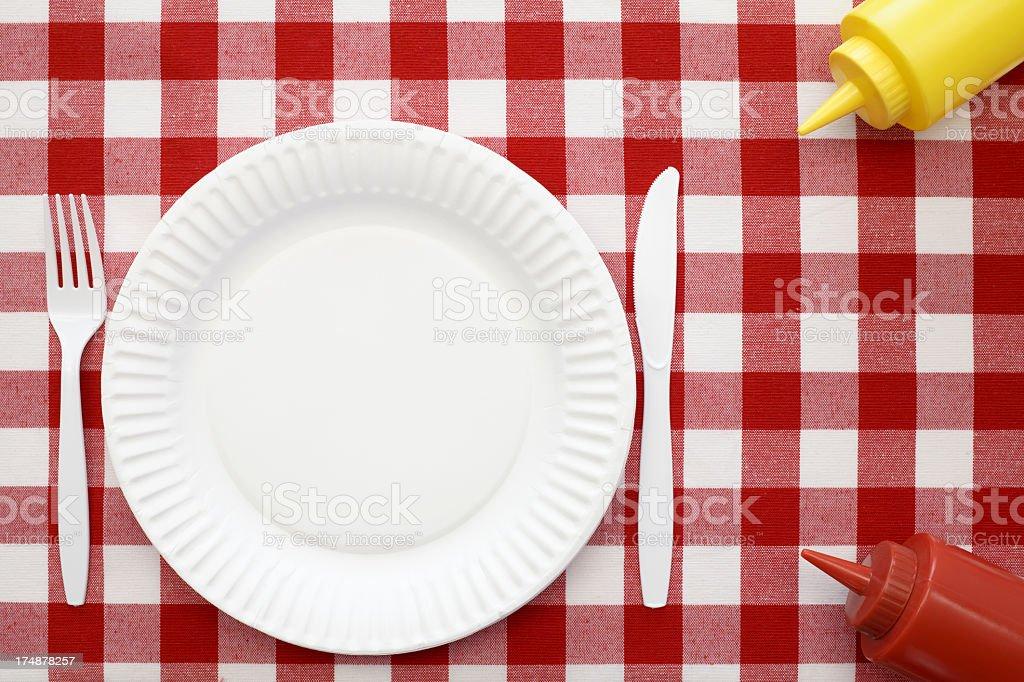Picnic setting with ketchup and mustard stock photo