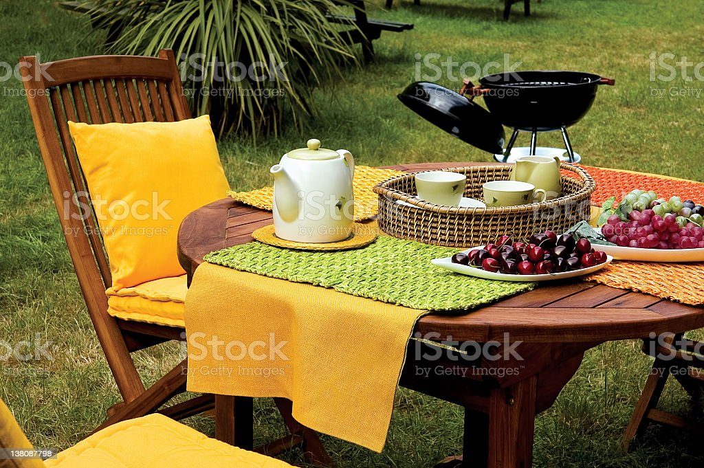 picnic table and barbecue on garden royalty-free stock photo