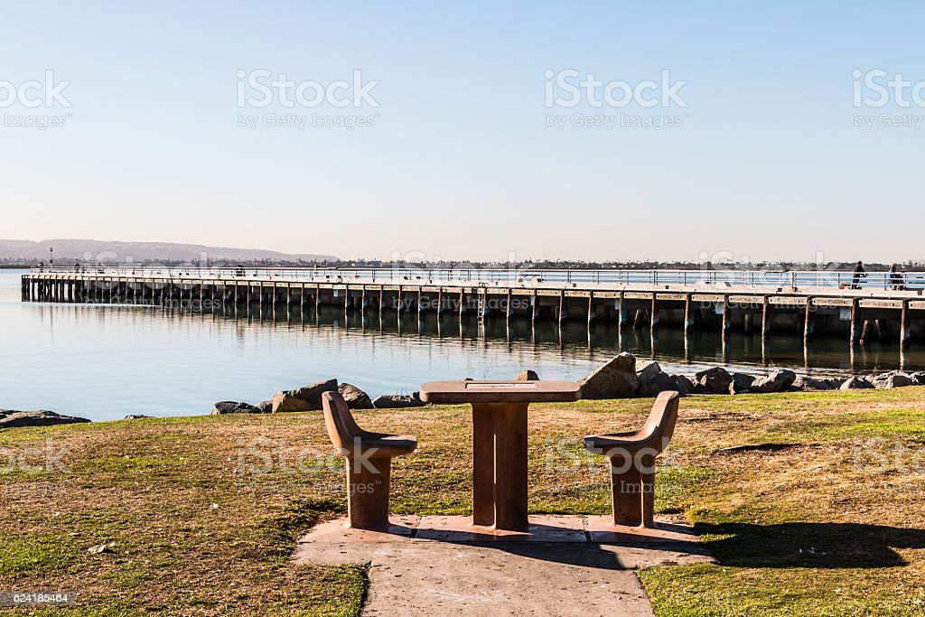 Picnic Table and Chairs with Pier in Chula Vista, California stock photo