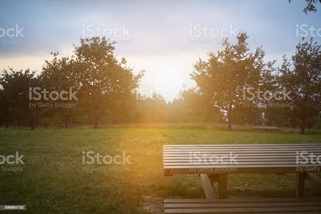 Picnic table at sunset stock photo