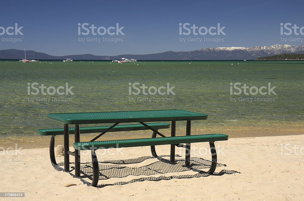 Picnic table on Lake Tahoe beach stock photo
