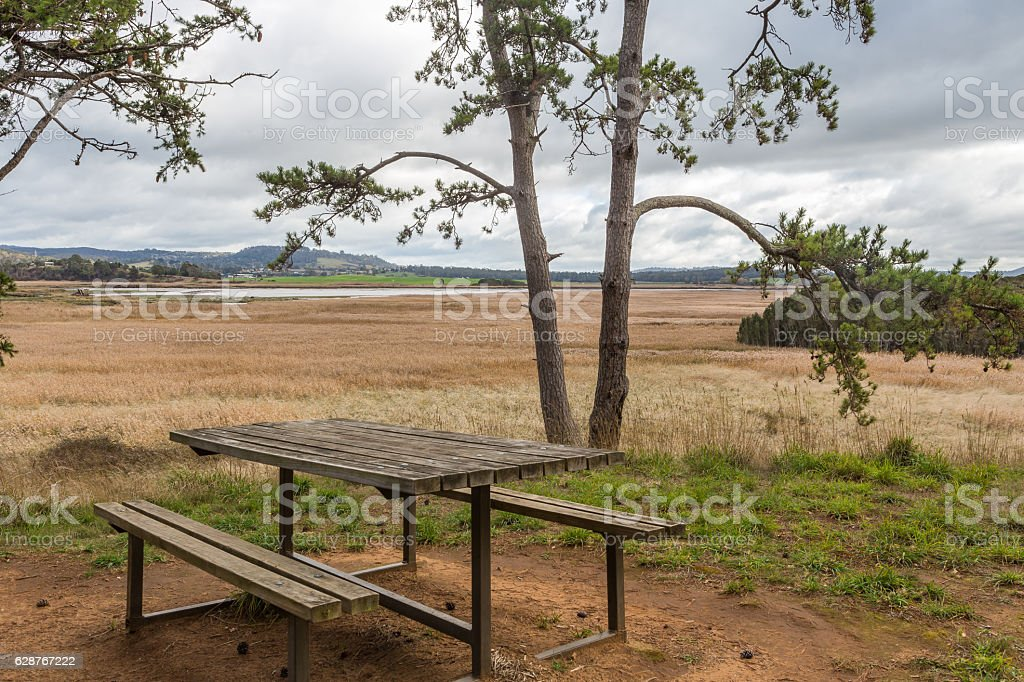 Picnic table on Tamar Island with scenic view over wetlands stock photo