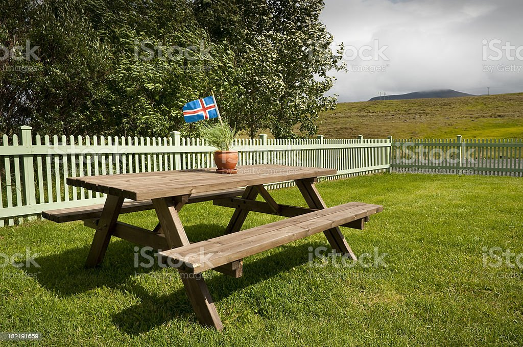 Picnic table with iceland's flag royalty-free stock photo