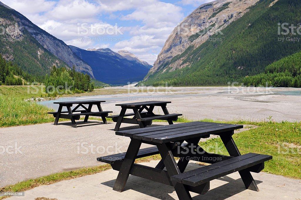 Picnic tables  near the river in Field, Canada stock photo