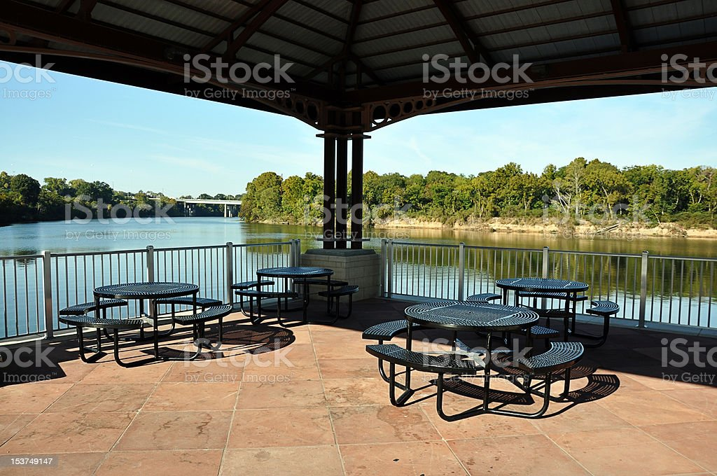 Picnic Tables on Pavilion Overlooking River stock photo