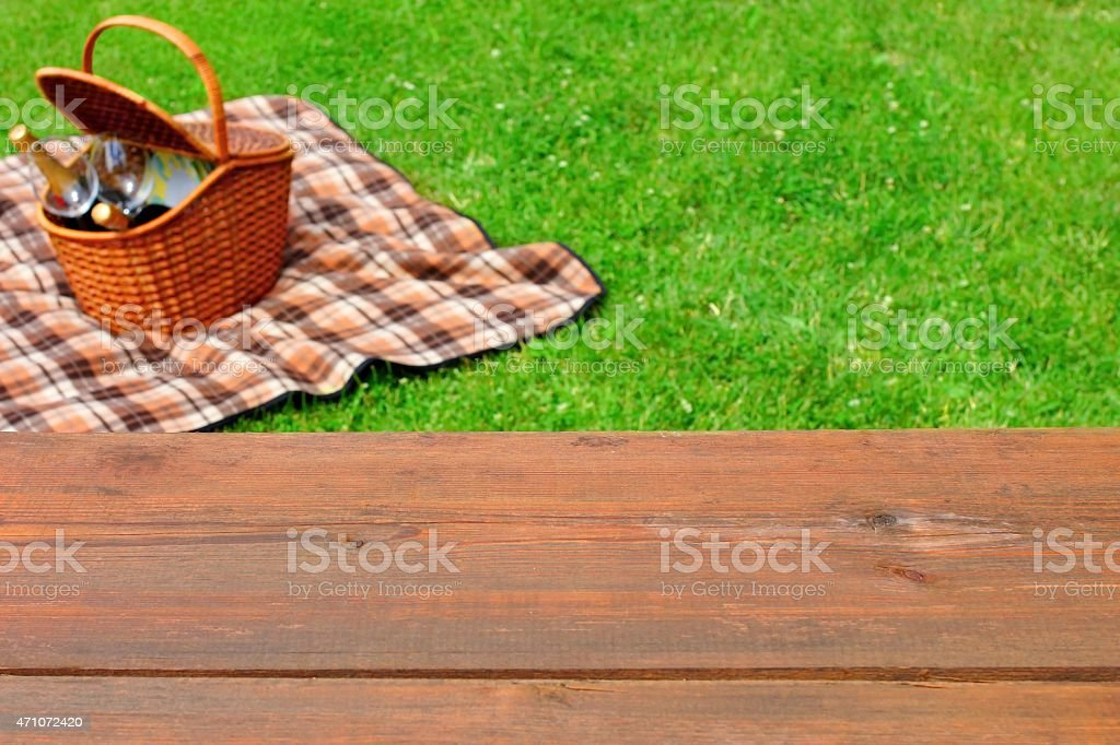 Picnic Tabletop Close-up. Picnic Basket and Blanket On The Lawn stock photo