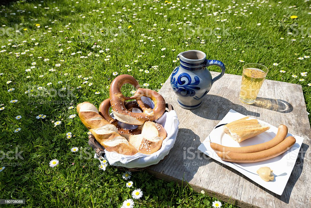 Picnic with Hessian Cider  Jug and Lye rolls stock photo