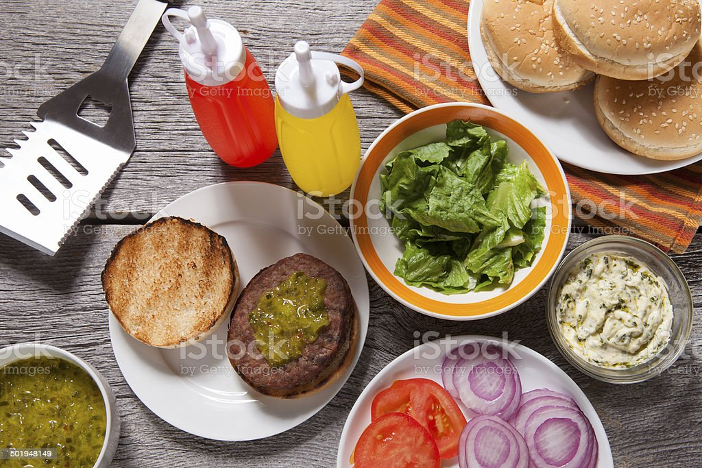 picnic-hamburger and condiments stock photo