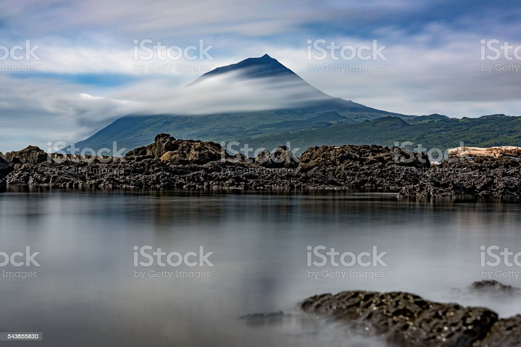 Pico volcano, surrounded by Atlantic clouds stock photo
