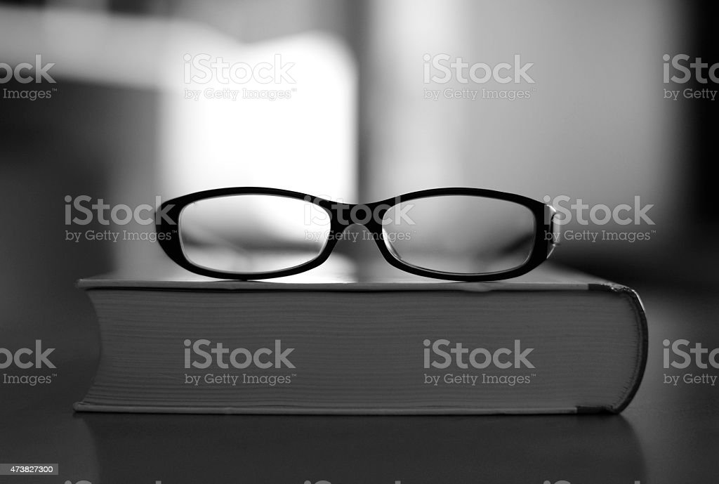 Picture books, reading glasses with foreplay. stock photo