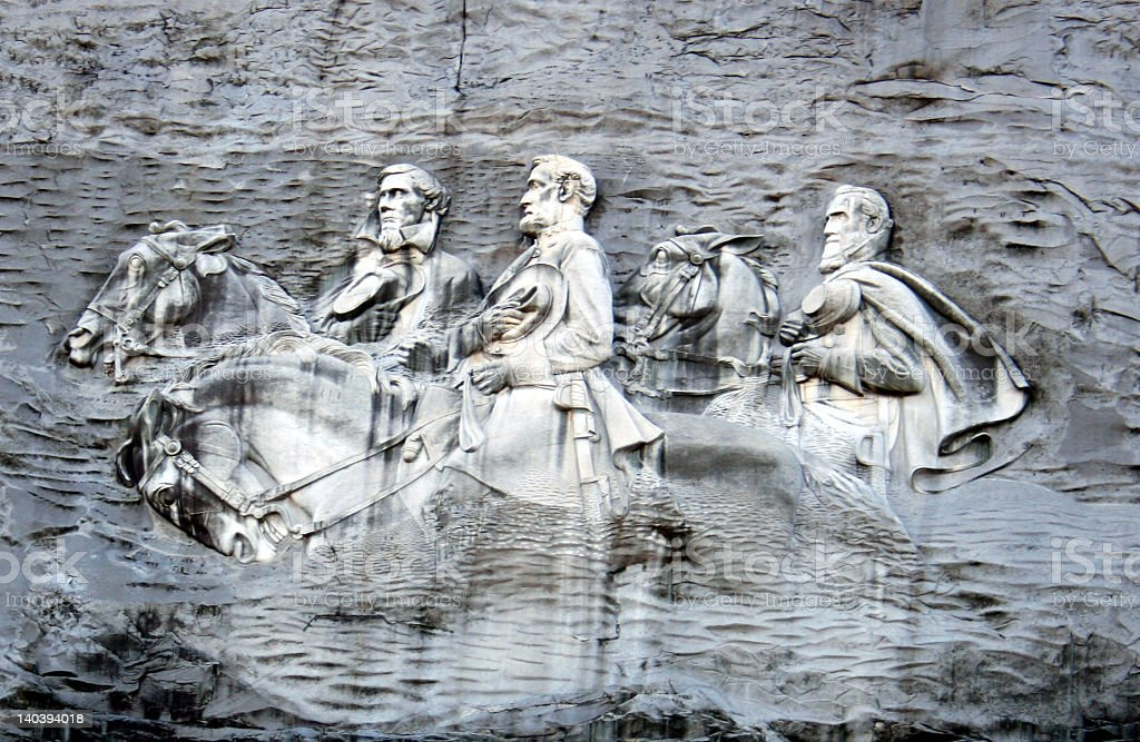 A picture depicted on this stone mountain of men stock photo