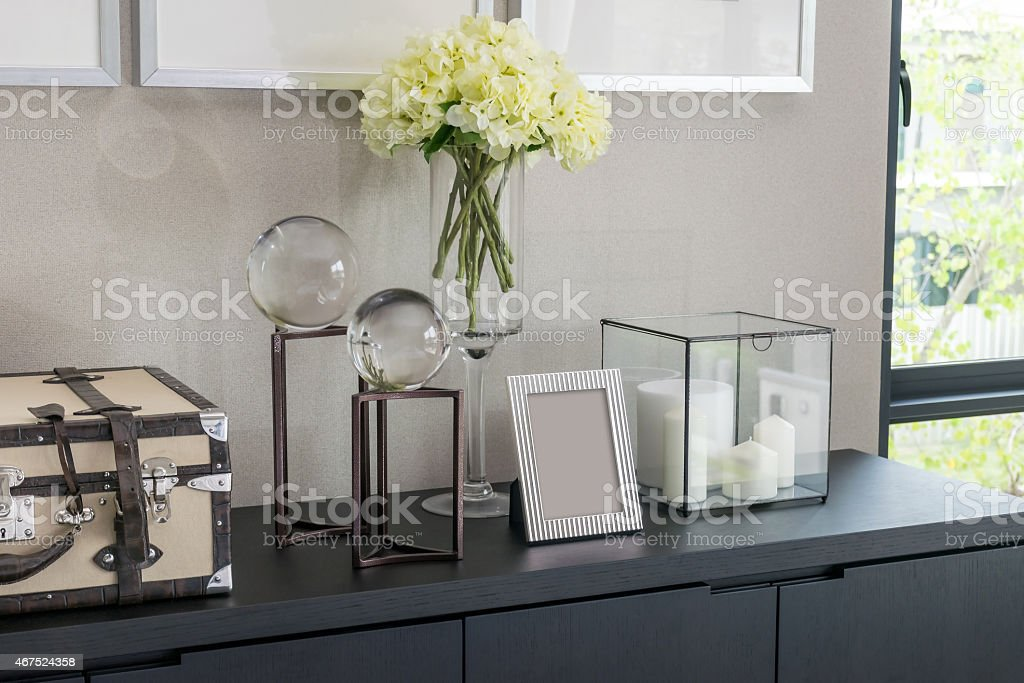 Picture frame and candle lamp on a table stock photo