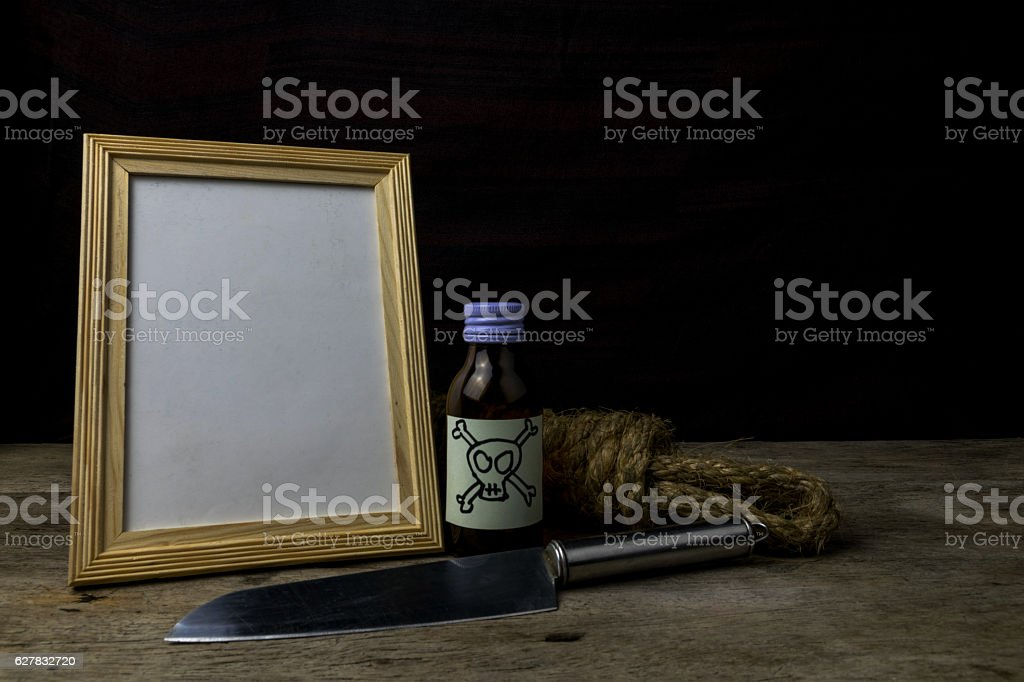 Picture frame and poison and knife. Concept Romance Suspense stock photo
