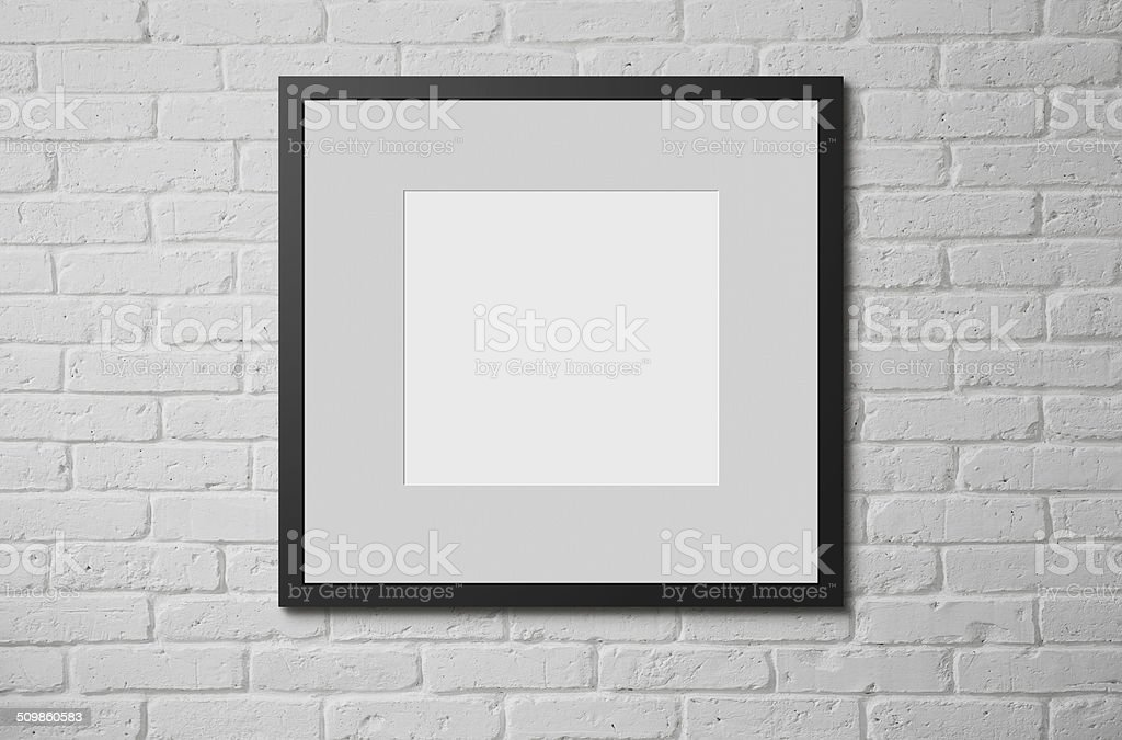 Picture frame at the wall stock photo