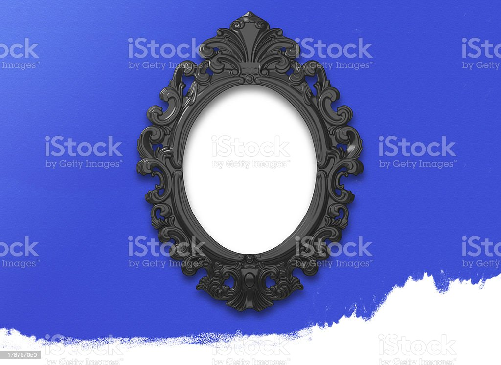 Picture Frame Black Oval Circle on blue wall. royalty-free stock photo