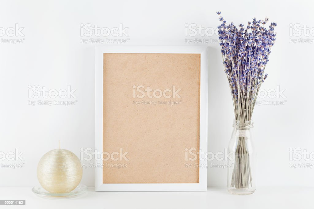 Picture frame decorated lavender flowers with candle. Mockup for website design or blogging. stock photo