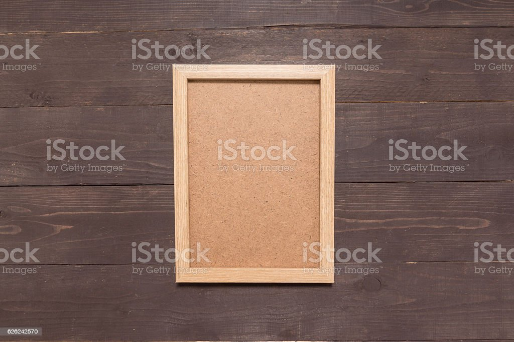 Picture frame is on the wooden background stock photo