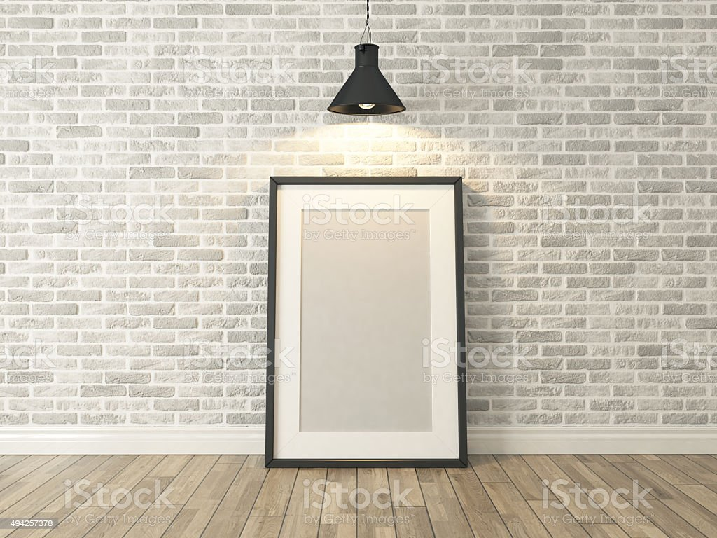 picture frame on the white brick wall and wood stock photo