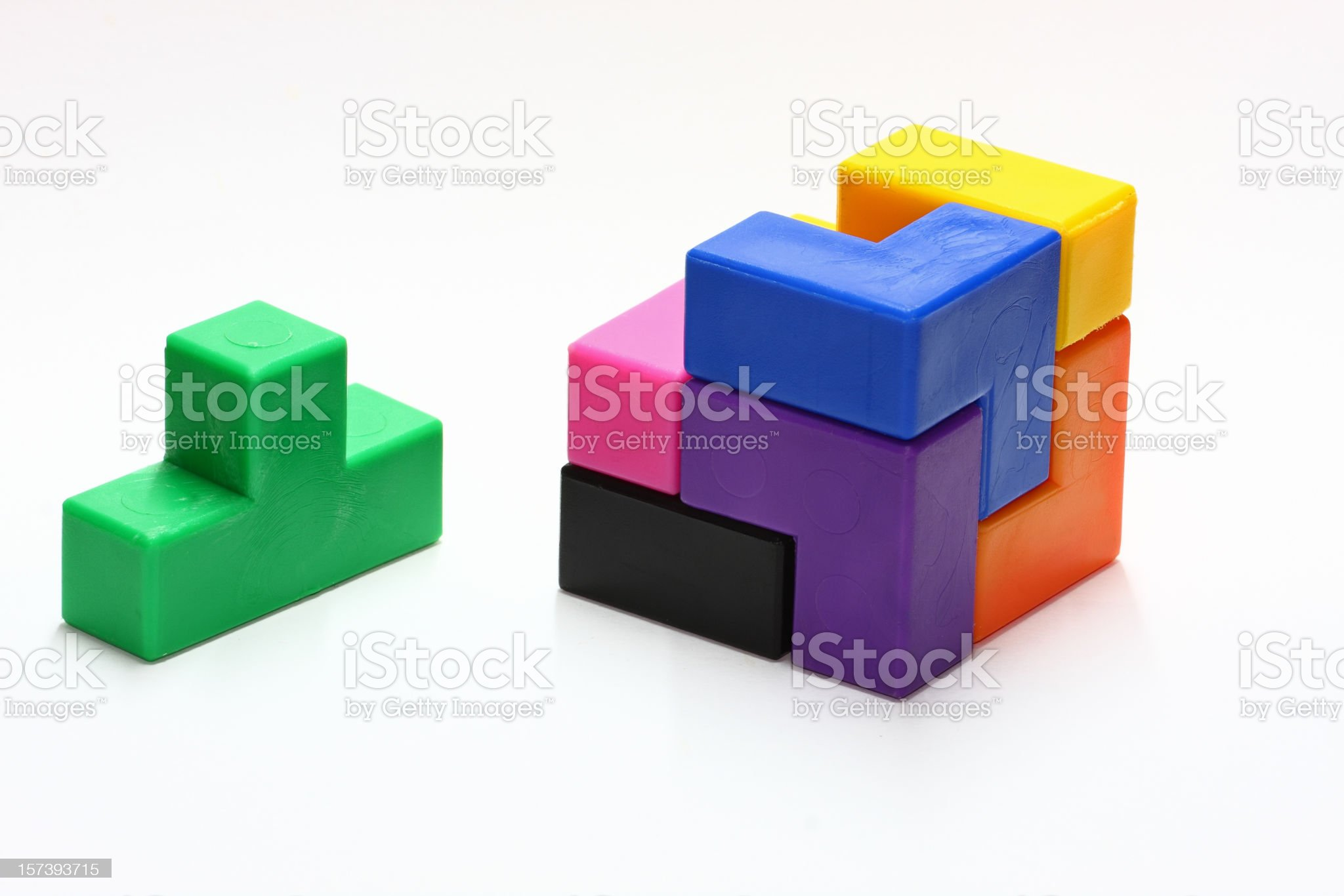 Picture of a 3D puzzle with one piece sitting to one side royalty-free stock photo