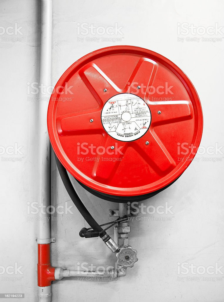 A picture of a bright red fire hose reel royalty-free stock photo