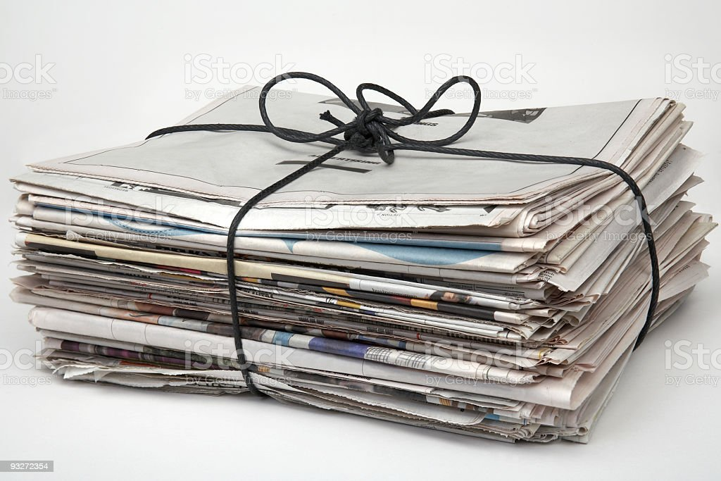 A picture of a bundle of newspapers stock photo