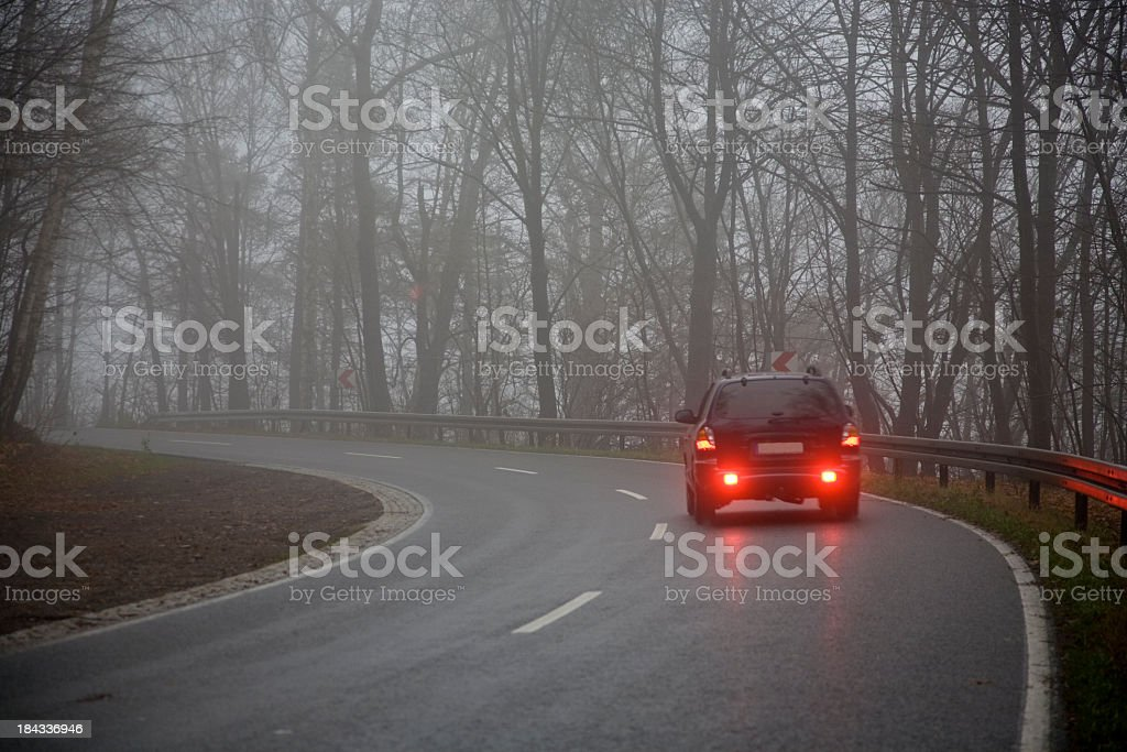 Picture of a car on the road on a gray day stock photo