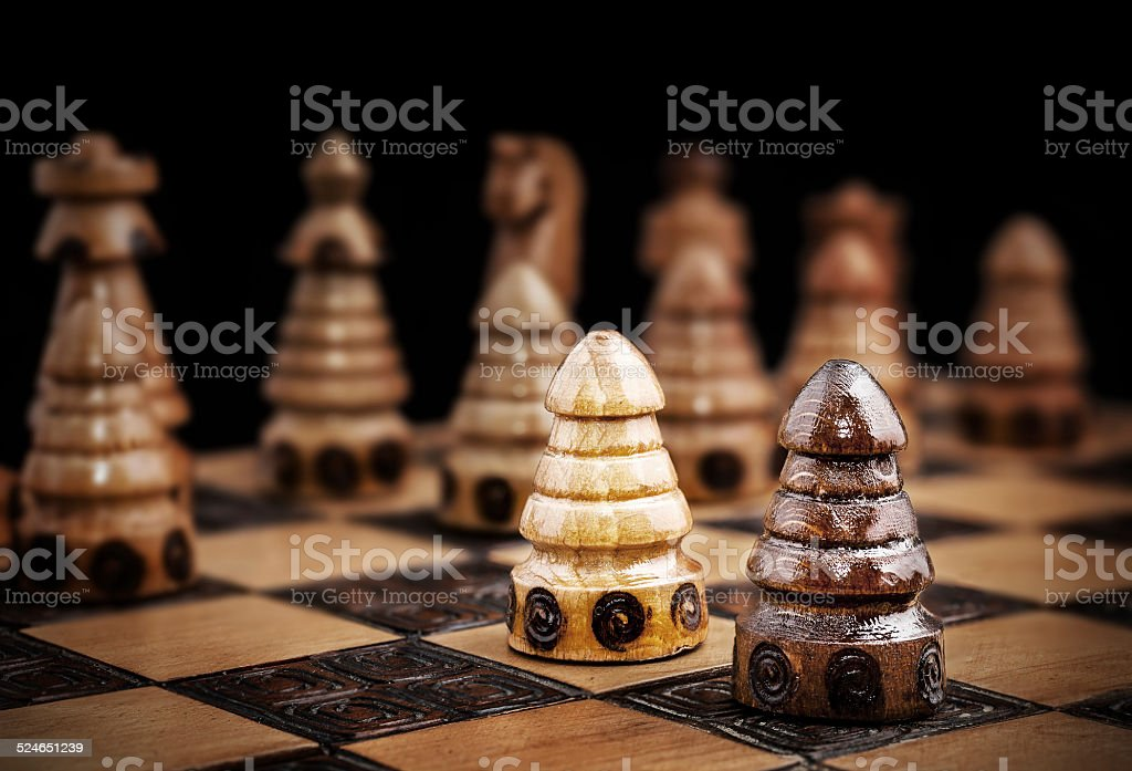 Picture of a chess, one against all concept. stock photo