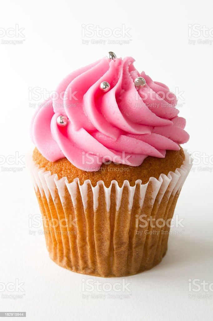 A picture of a cupcake with strawberry frosting stock photo