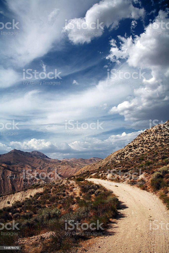 Picture of a desert road under blue sky royalty-free stock photo