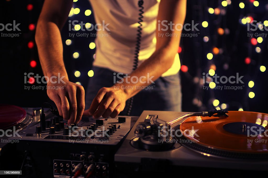 A picture of a DJ working in a club stock photo