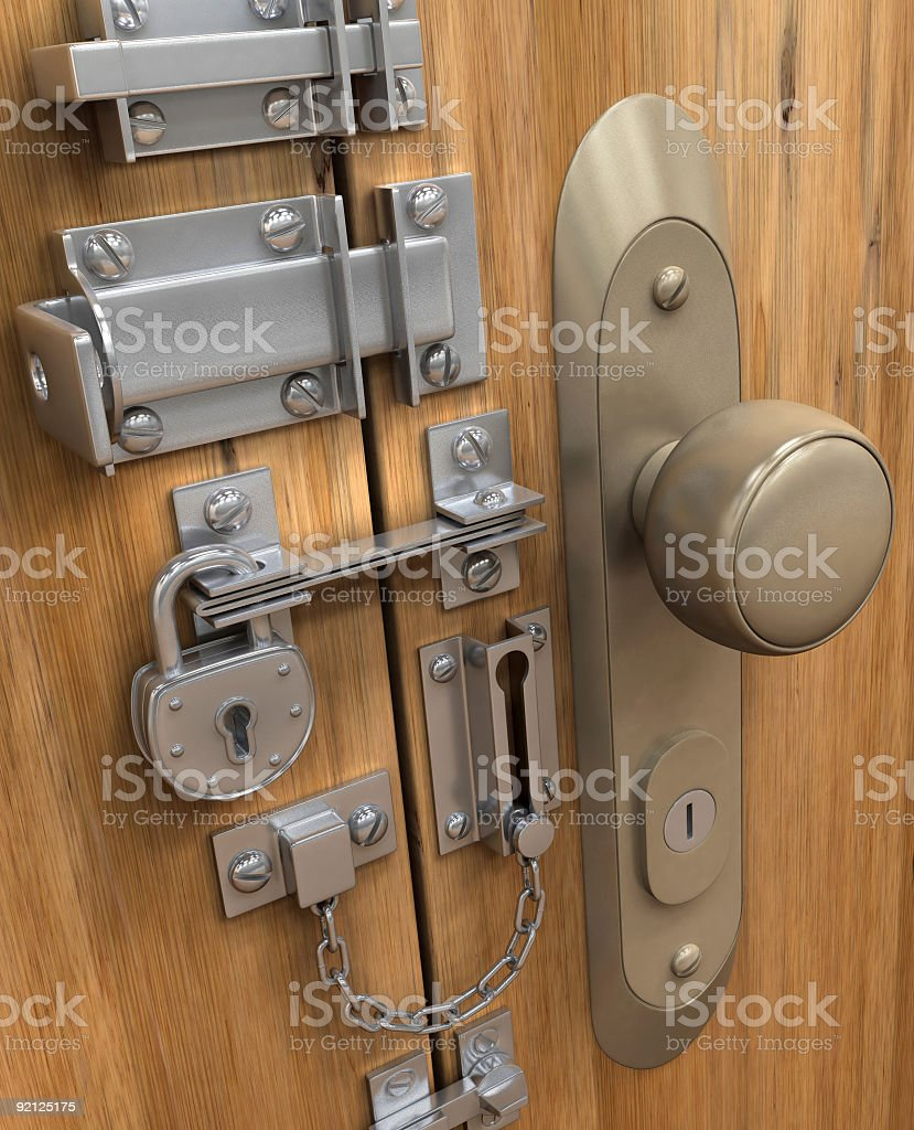 A picture of a door with several locks stock photo