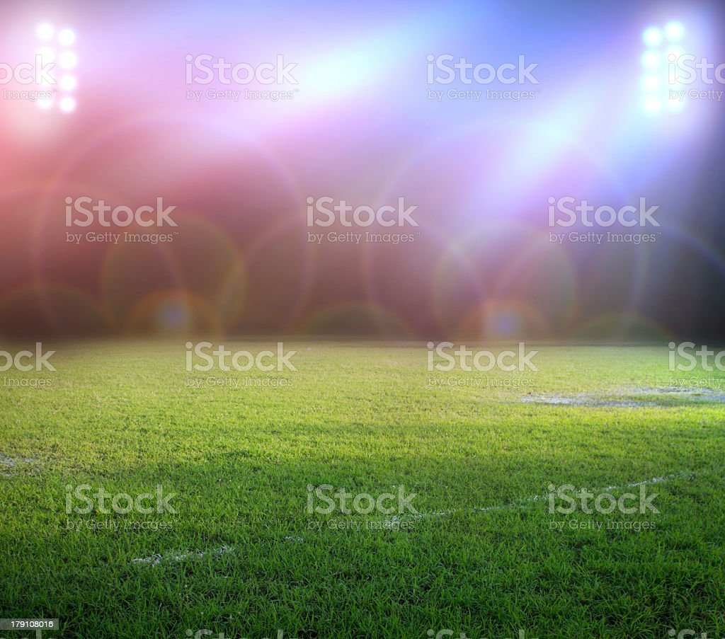 Picture of a field with stadium lights out and causing halo royalty-free stock photo