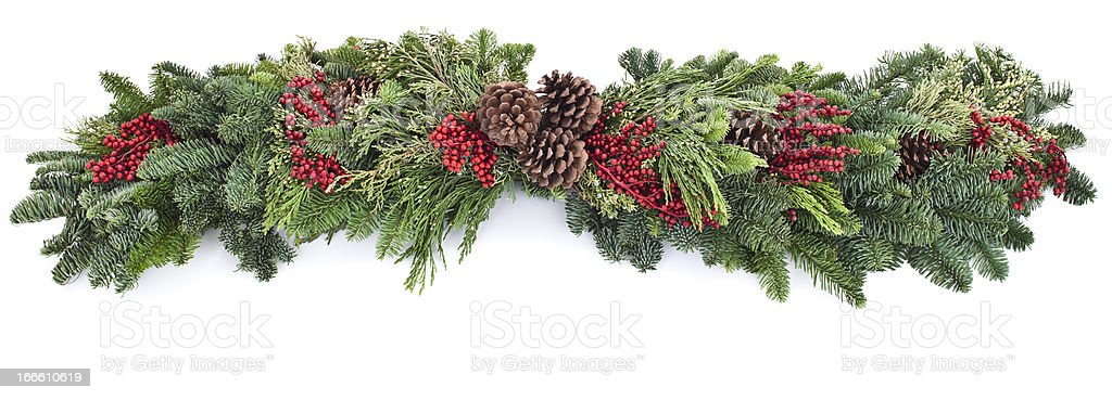 A picture of a garland with red and green leaves stock photo