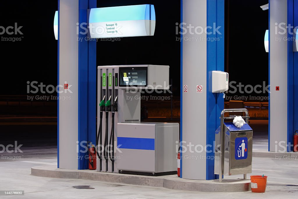 A picture of a gas station at night time stock photo