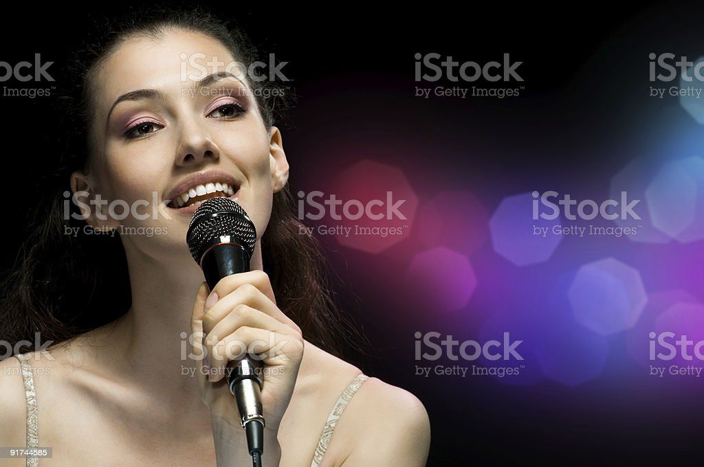 A picture of a girl holding a microphone stock photo