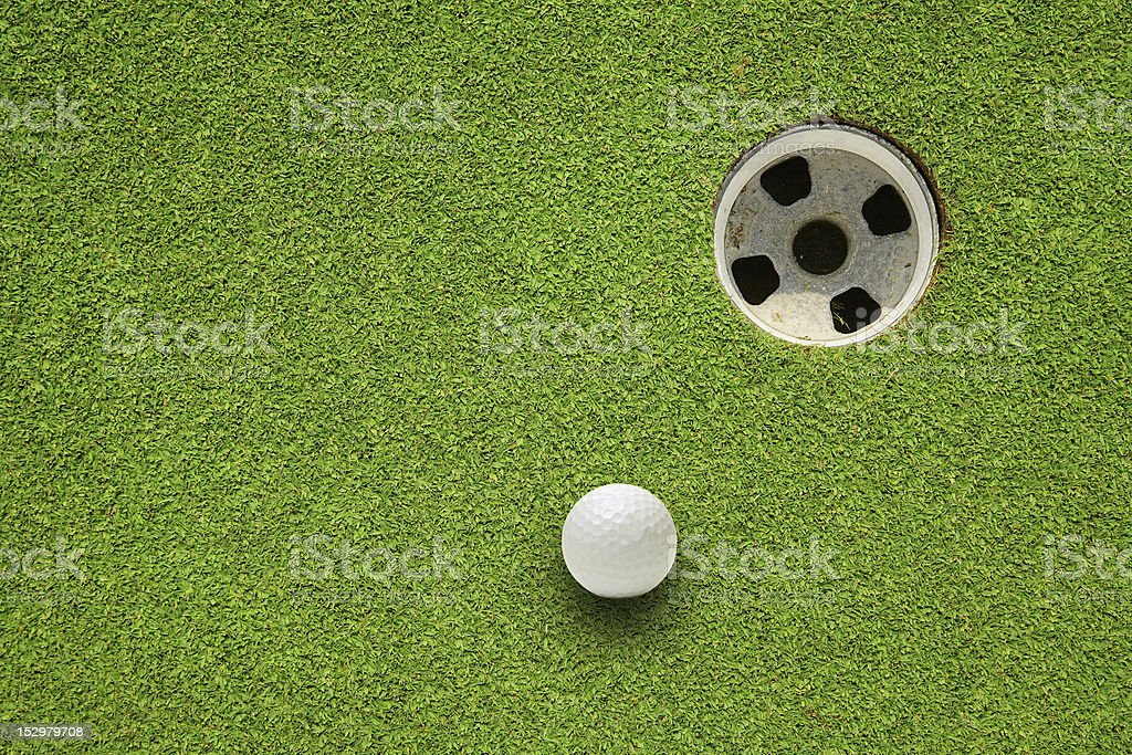 A picture of a golf ball almost in the hole stock photo