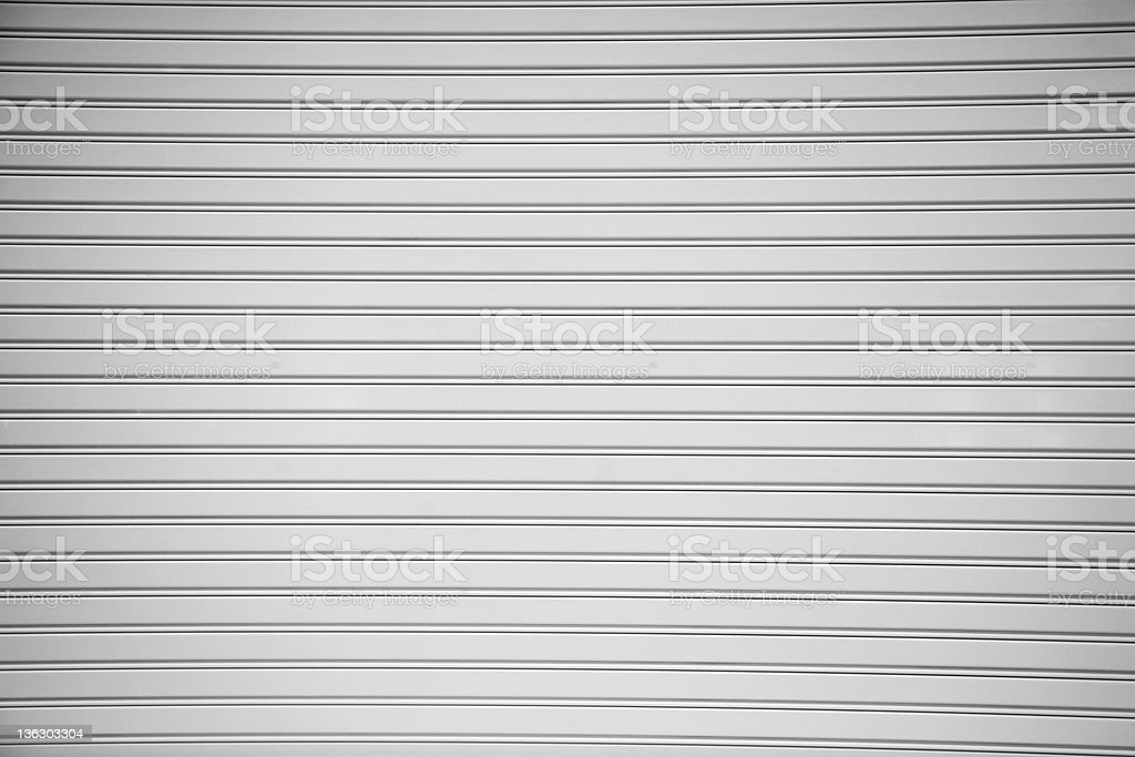 A picture of a gray rolled steel shutter door stock photo