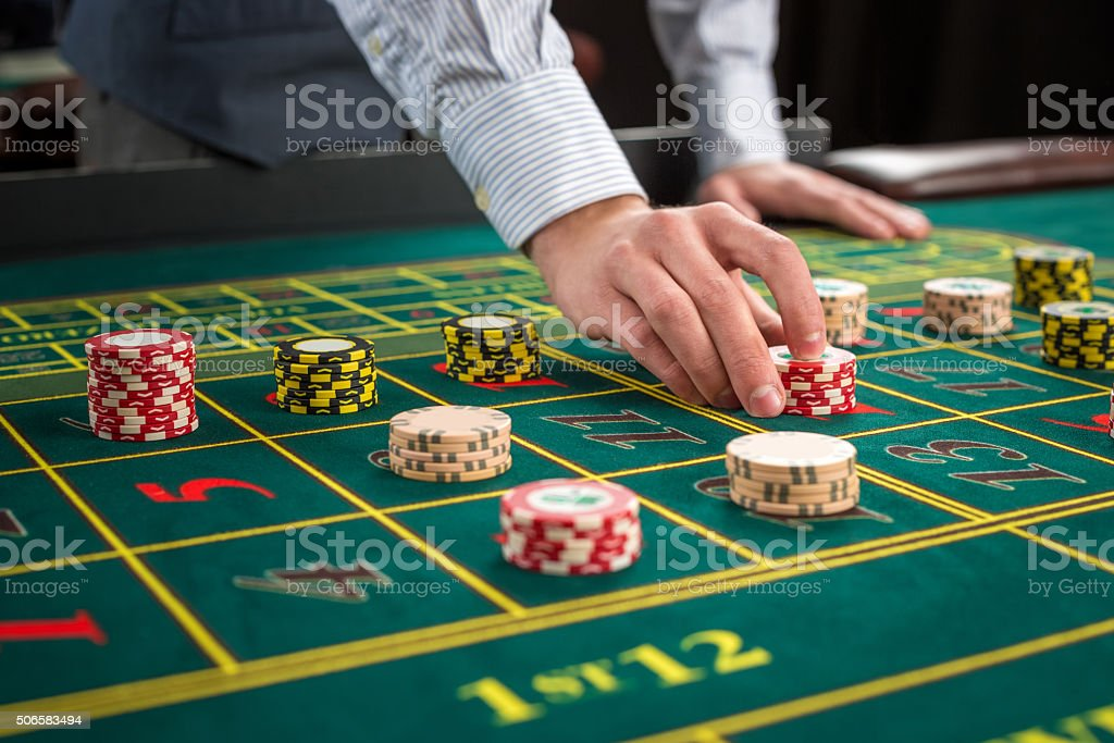 Picture of a green table and betting with chips. stock photo