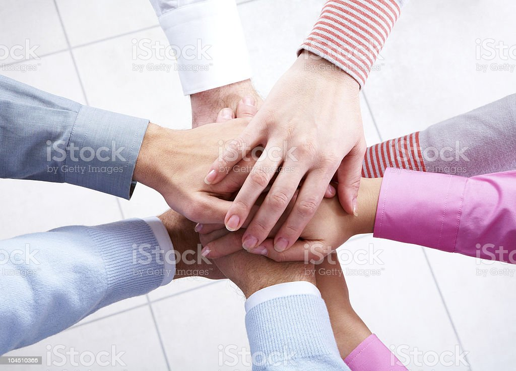 A picture of a group of people's hands symbolizing unity royalty-free stock photo
