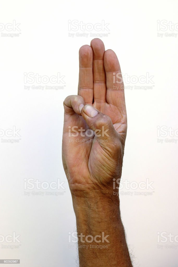 A picture of a hand holding up three fingers stock photo