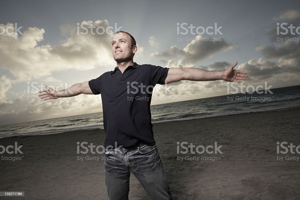 Picture of a happy male standing on the beach royalty-free stock photo