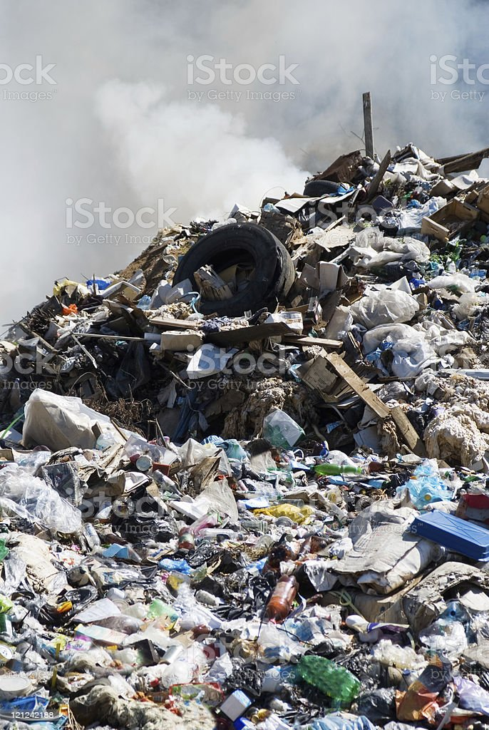 Picture of a landfill smoking and on fire stock photo