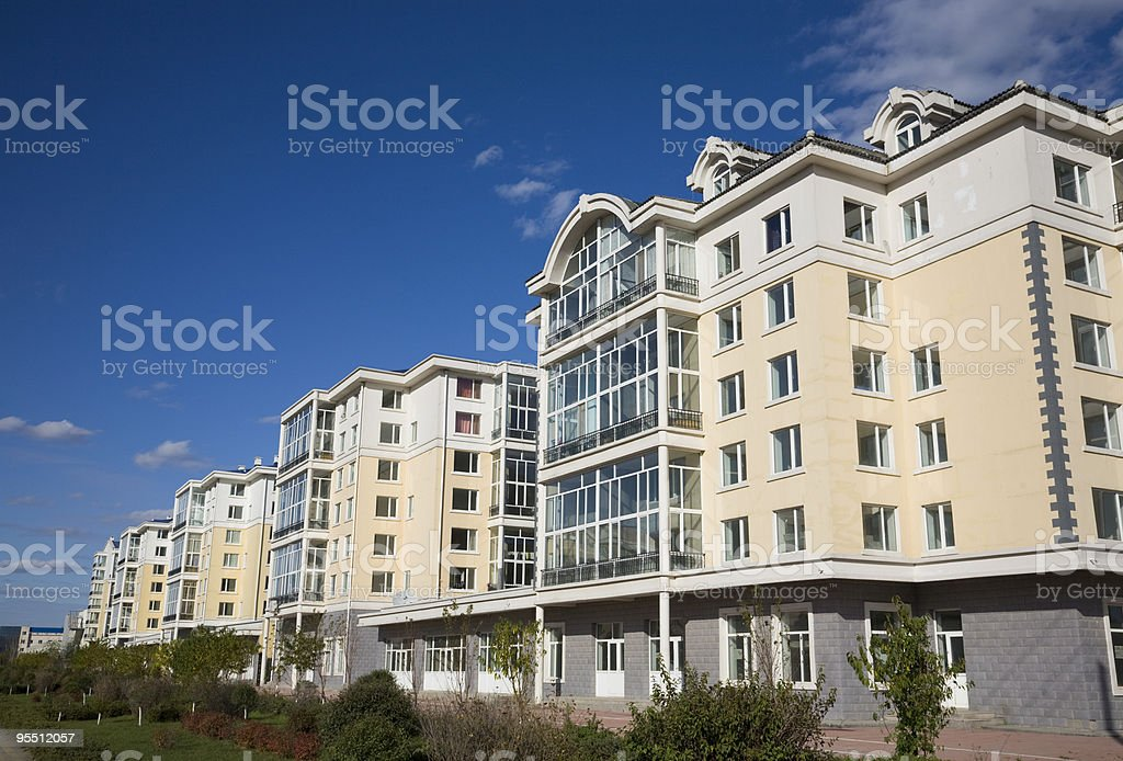 A picture of a large building with the trees surrounding it stock photo