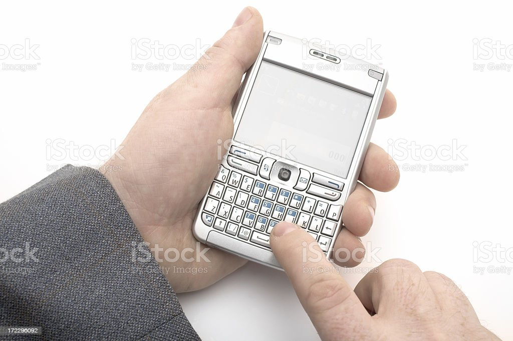 A picture of a male using his early stage smartphone to type royalty-free stock photo