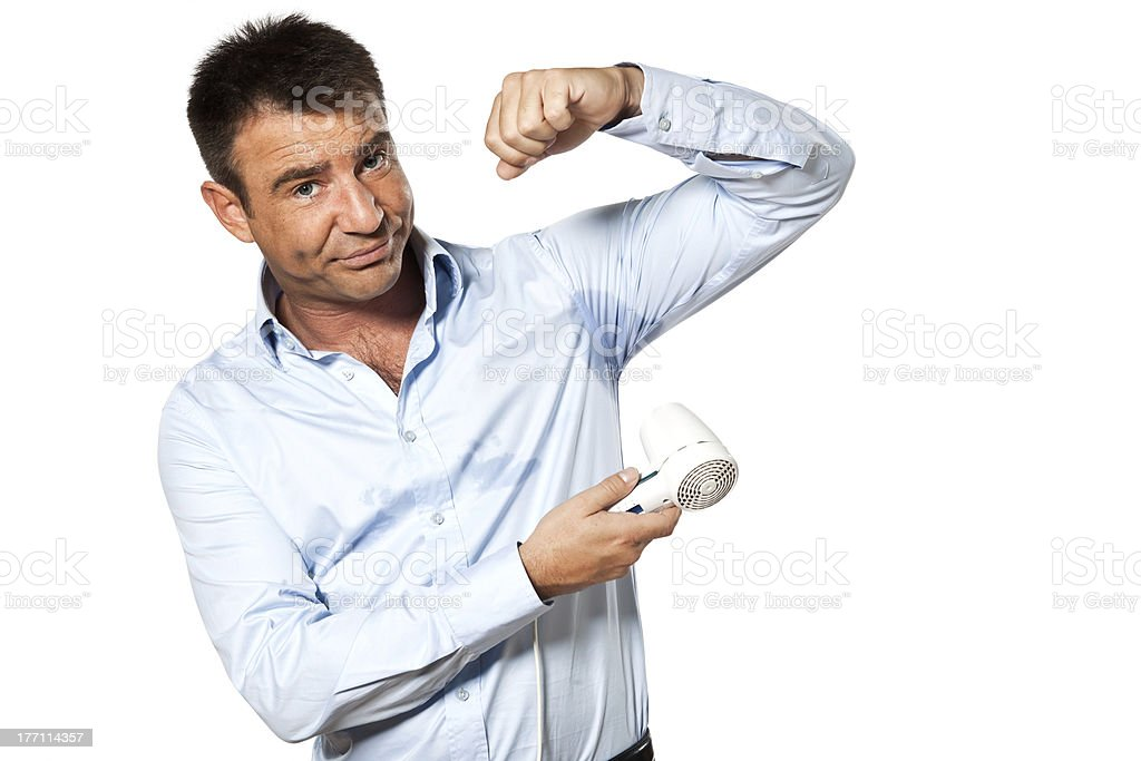 A picture of a man blow drying his underarms stock photo