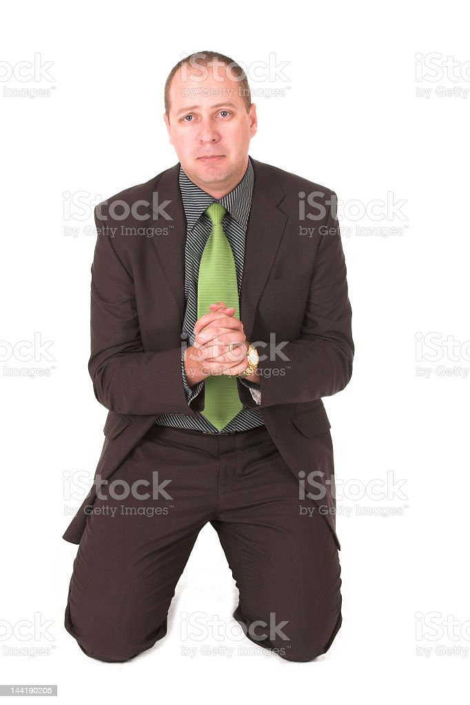A picture of a man in a business suit begging stock photo