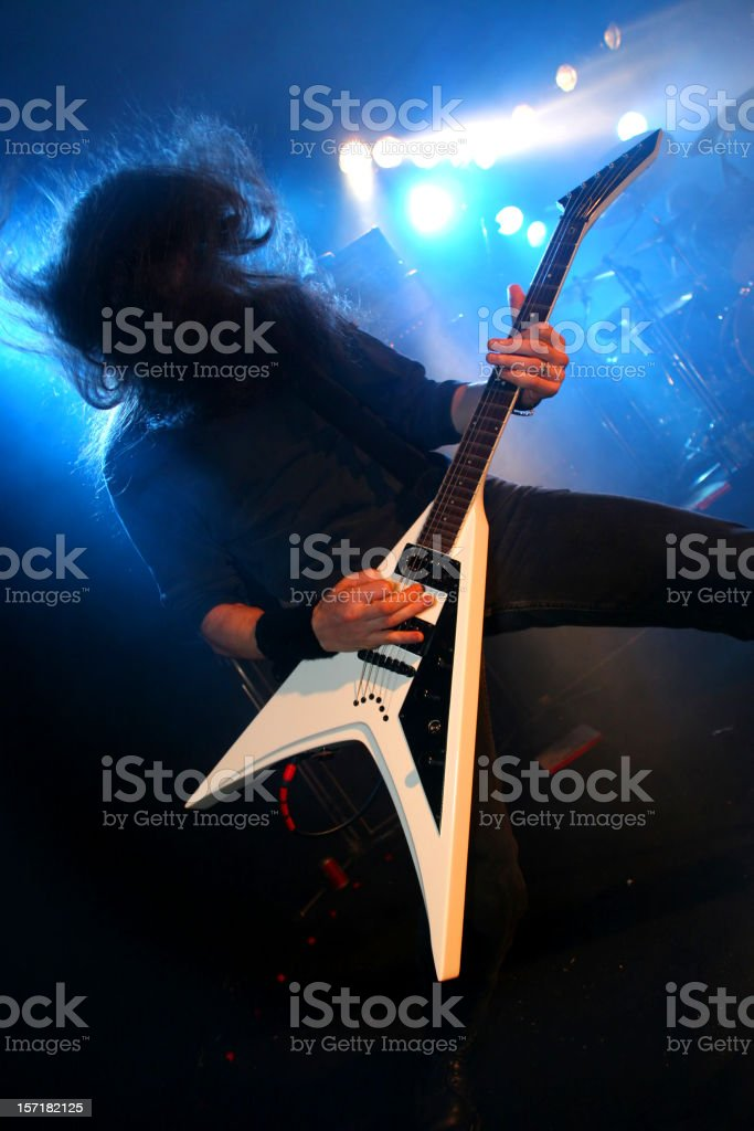 Guitarist on blue stock photo