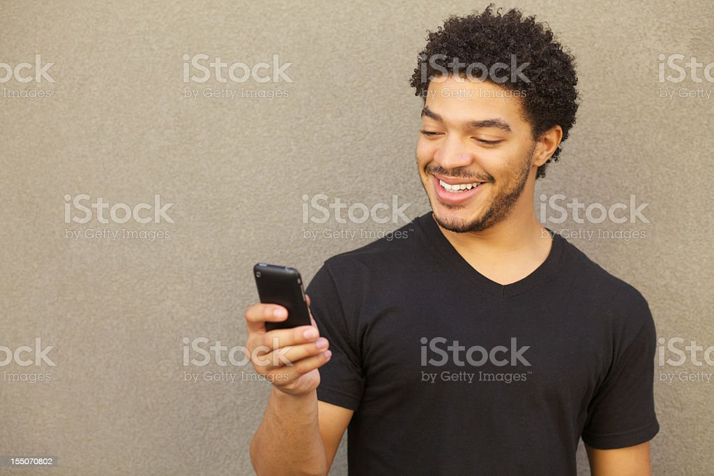 A picture of a Man Text Messaging royalty-free stock photo